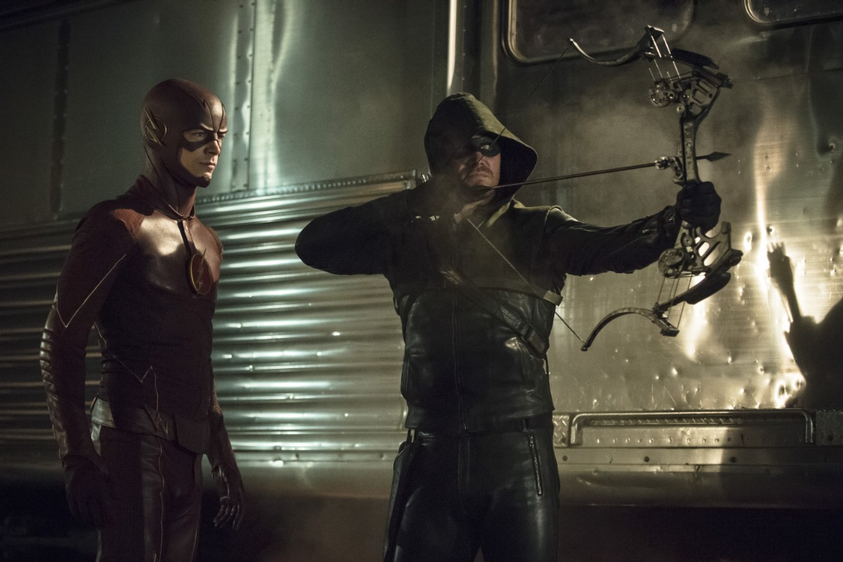 """Arrow -- """"The Brave and the Bold"""" -- Image AR308a_0179b -- Pictured (L-R): Grant Gustin as The Flash and Stephen Amell as The Arrow -- Photo: Cate Cameron/The CW -- © 2014 The CW Network, LLC. All Rights Reserved."""